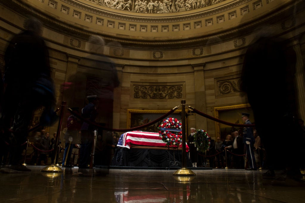 A flag-draped coffin in the Capitol rotunda.