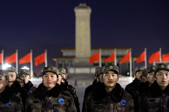 Chinese soldiers stand in line as they prepare to watch the daily flag-raising ceremony on New Year's Day on Tiananmen Square in Beijing.