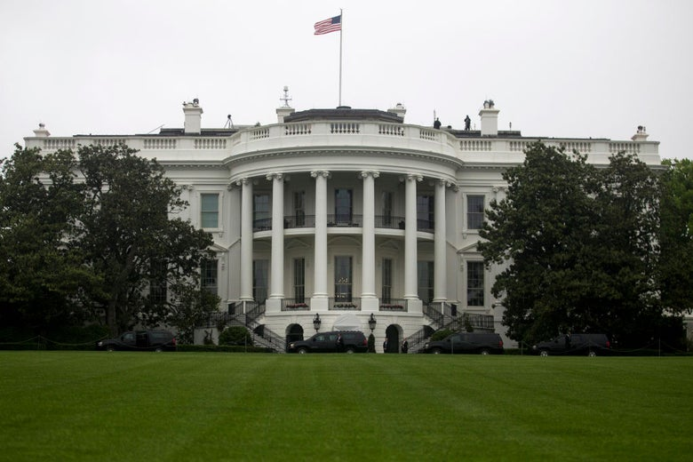 The White House and its lawn, photographed straight on.