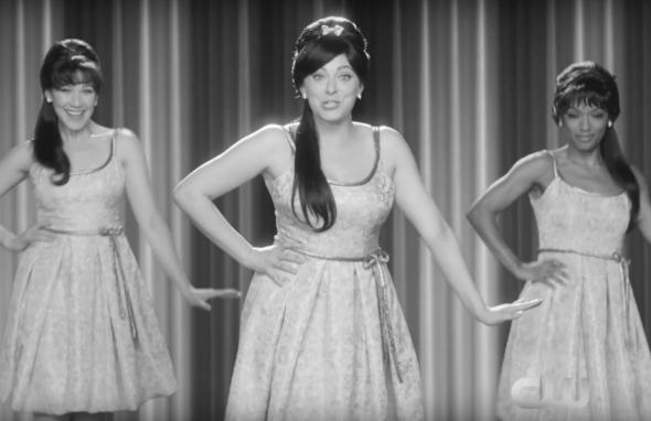 Rachel Bloom and backup dancers wear 1960-style hairdos