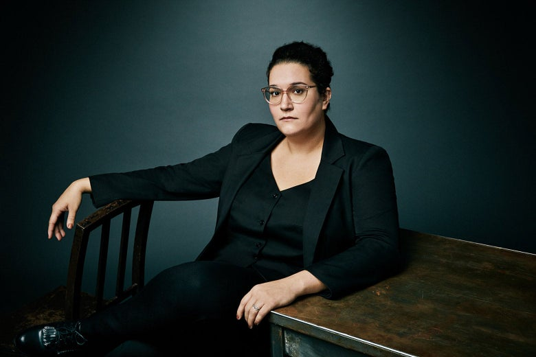 Carmen Maria Machado sitting at a table.