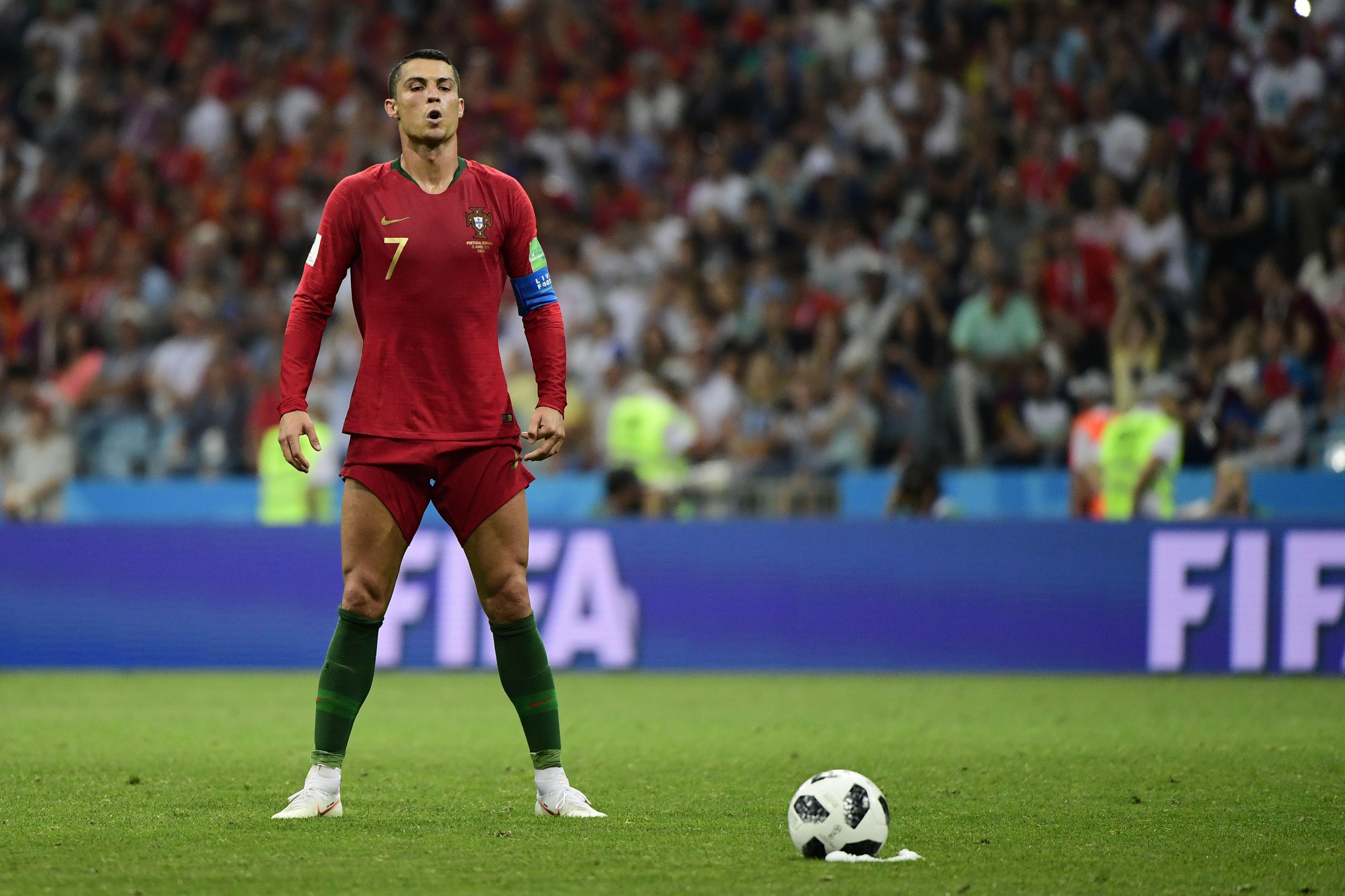 Portugal's forward Cristiano Ronaldo prepares to take a free kick.