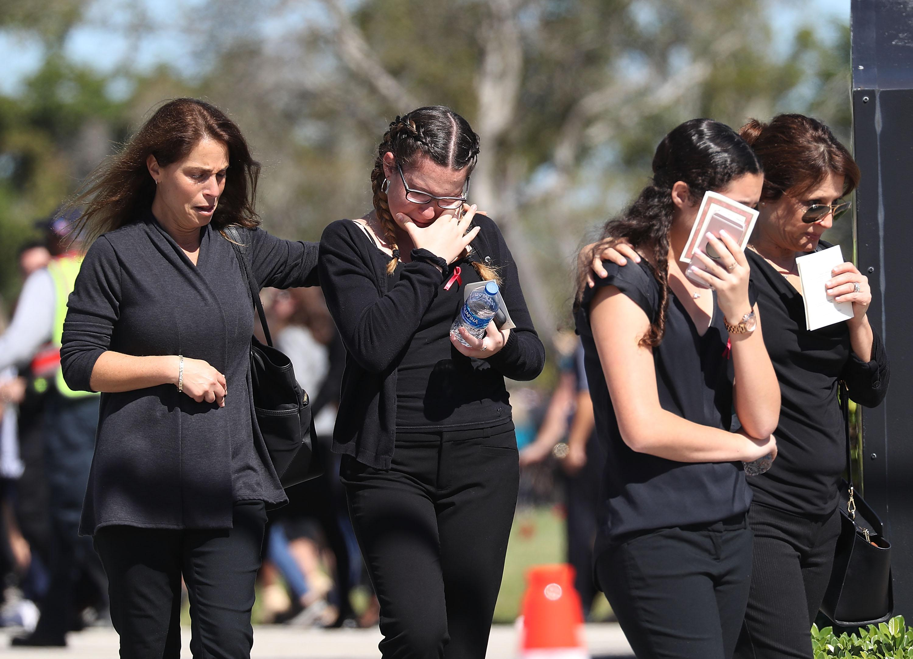Mourners attend a funeral on February 16, 2018 in Parkland, Florida.