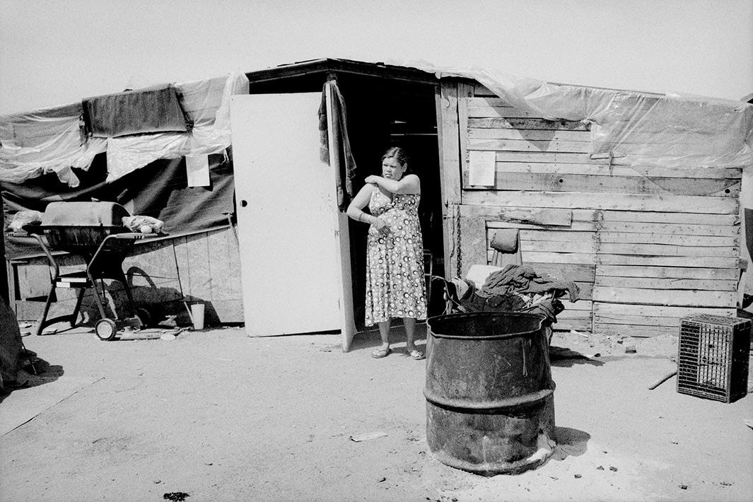 Woman at her shantytown home in Fresno, California.