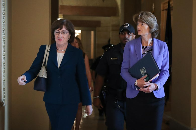 Sen. Susan Collins and Sen. Lisa Murkowski walk together as they arrive to a closed-door lunch meeting of GOP Senators at the U.S. Capitol, October 3, 2018 in Washington, D.C.