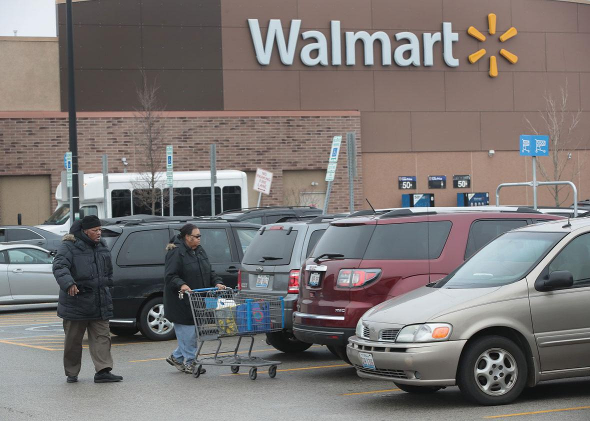 Customers shop at a Walmart store.