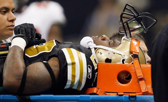 Tracy Porter of the New Orleans Saints is carried off the field on a stretcher.
