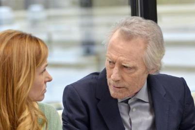 A man talks to a woman.