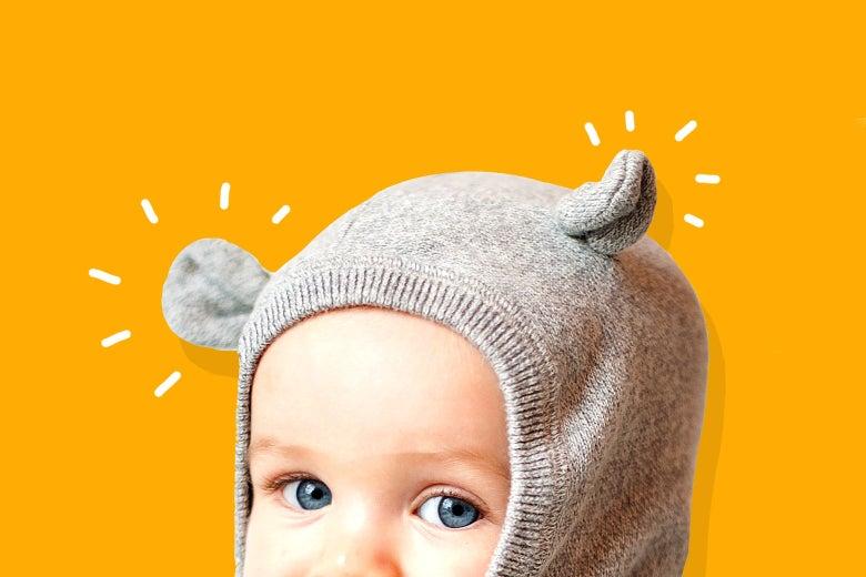 Baby wearing a cute animal-ear hood.