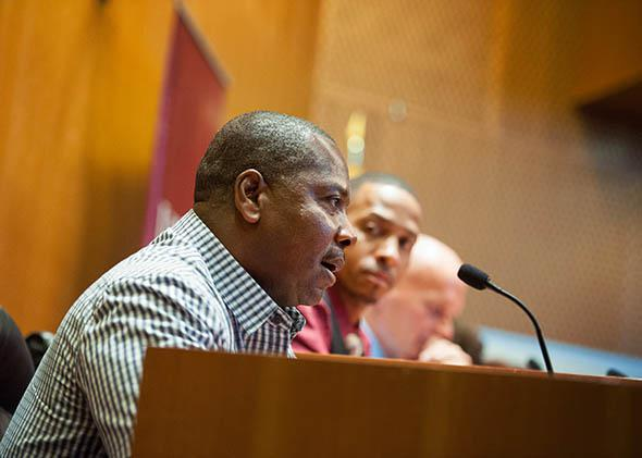 Kash Register speaking on a panel of exonerees at an Innocence Day event at Loyola Law School in October 2014.