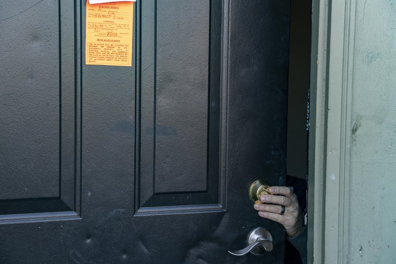An eviction notice is posted and the lock is changed on a residence in the unincorporated community of Galloway on March 3, 2021 west of Columbus, Ohio. Property Management teams are given 1 1/2 hours to remove all items from the property under supervision of the service bailiff. (Photo by Stephen Zenner/Getty Images)