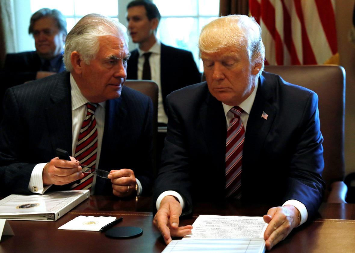 U.S. President Donald Trump talks with Secretary of State Rex Tillerson