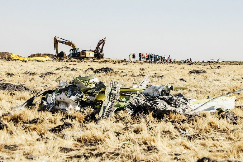 A power shovel digs next to debris at the Ethiopia Airlines' crash site on March 11, 2019.