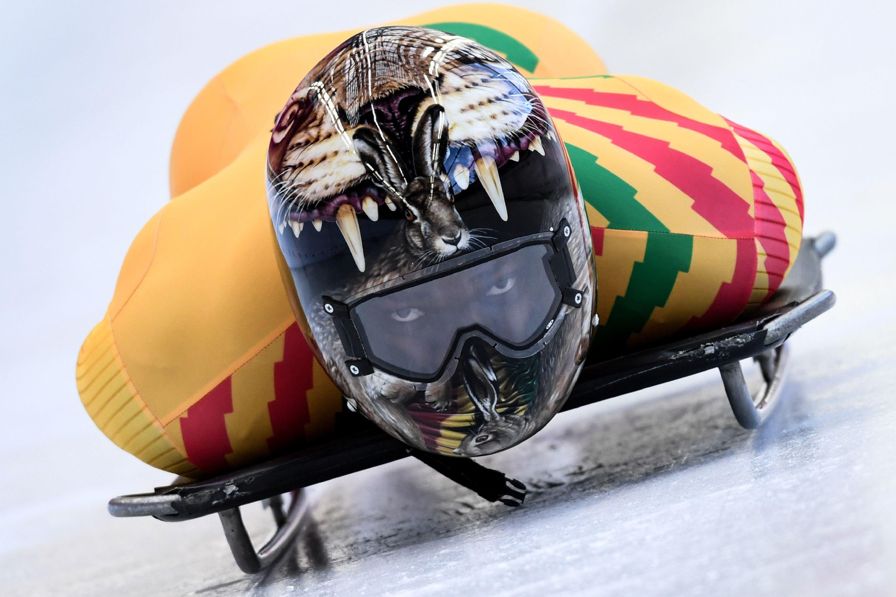 TOPSHOT - Ghana's Akwasi Frimpong takes part in a training session for the men's skeleton event at the Olympic Sliding Centre, during the Pyeongchang 2018 Winter Olympic Games in Pyeongchang, on February 11, 2018.                   / AFP PHOTO / Kirill KUDRYAVTSEV        (Photo credit should read KIRILL KUDRYAVTSEV/AFP/Getty Images)