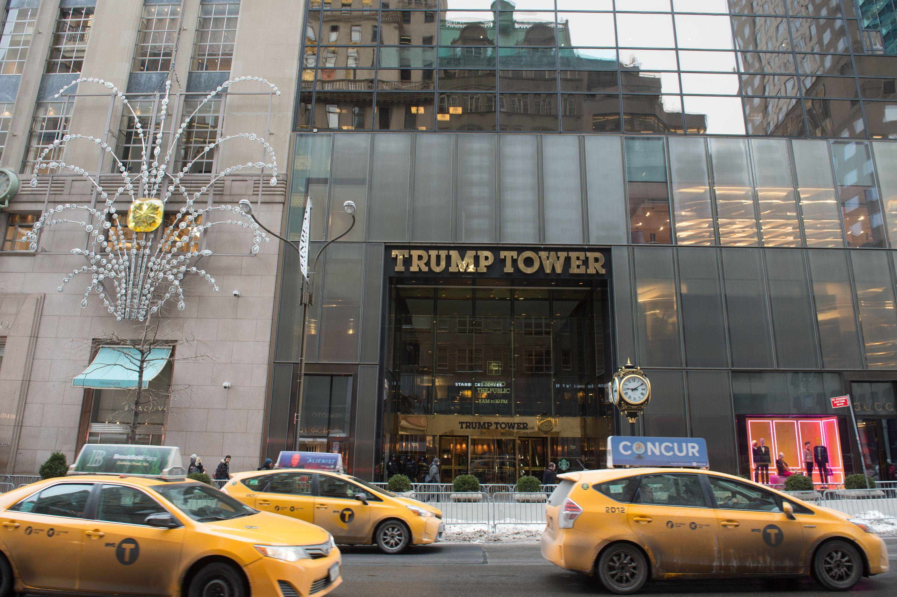 Cars drive past the front of Trump Tower on Fifth Avenue on January 8, 2018 in New York.