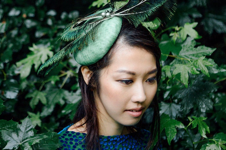 Miho Hazama against a backdrop of green leaves.