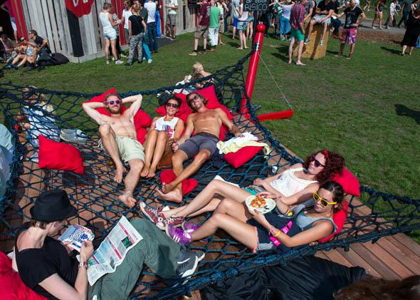 Visitors to the Lowlands Festival relax on a giant hammock on the second day of the Lowlands festival in Biddinghuizen, the Netherlands, on August 17, 2013.