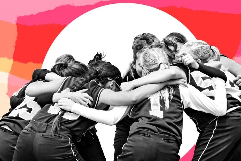 Girls soccer team in a huddle.