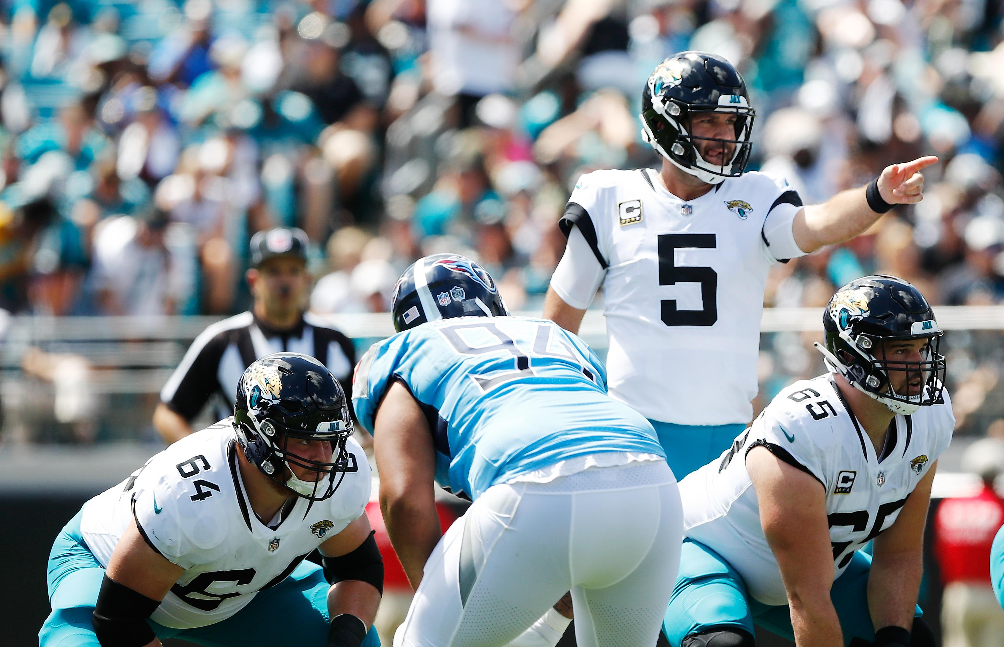 JACKSONVILLE, FL - SEPTEMBER 23:  Blake Bortles #5 of the Jacksonville Jaguars calls a play against the Tennessee Titans during their game at TIAA Bank Field on September 23, 2018 in Jacksonville, Florida.  (Photo by Wesley Hitt/Getty Images)