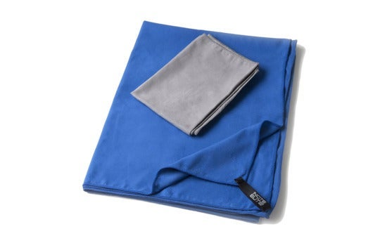 Small gray towel on top of a blue towel.