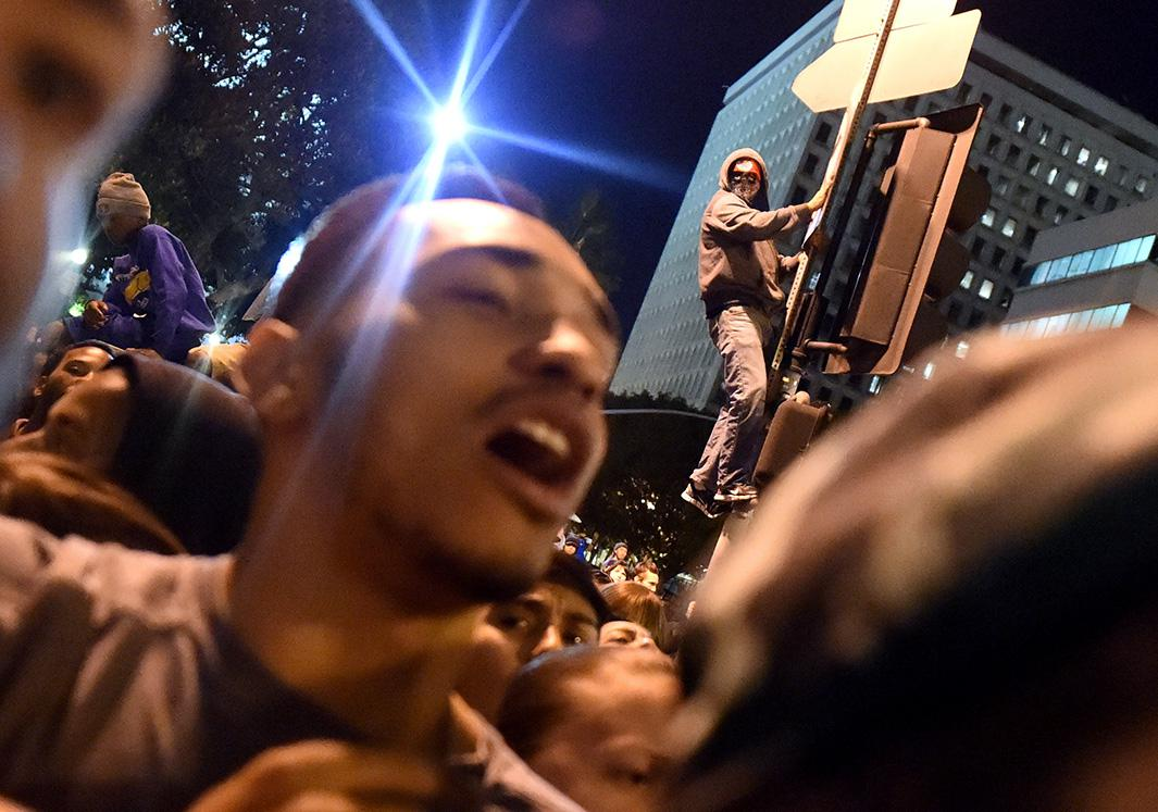 Protesters chant outside the Los Angeles police headquarters on Nov. 25, 2014, during demonstrations against a decision by a Ferguson, Missouri, grand jury not to indict a white police officer in the shooting of black teenager Michael Brown