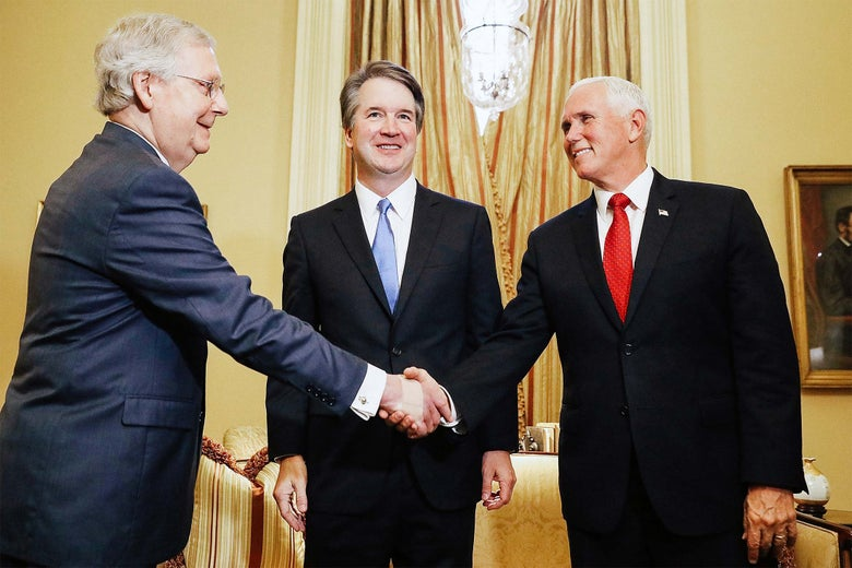Judge Brett Kavanaugh between Senate Majority Leader Mitch McConnell and Vice President Mike Pence before a meeting at the U.S. Capitol on Tuesday.