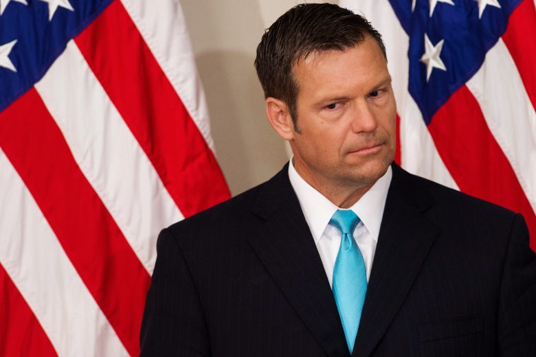 Kansas Secretary of State Kris Kobach listens as President Donald Trump speaks during the first meeting of the Presidential Advisory Commission on Election Integrity in the Eisenhower Executive Office Building next to the White House in Washington on July 19.