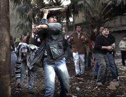 Anti-Egyptian-government demonstrators hurl stones at opponents, Cairo's Tahrir square, Feb. 3, 2011, 10th day of protests. Click image to expand.