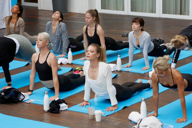 Women doing yoga.
