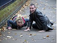 Billie Piper and Christopher Eccleston hit the ground in Dr. Who          Click image to expand.