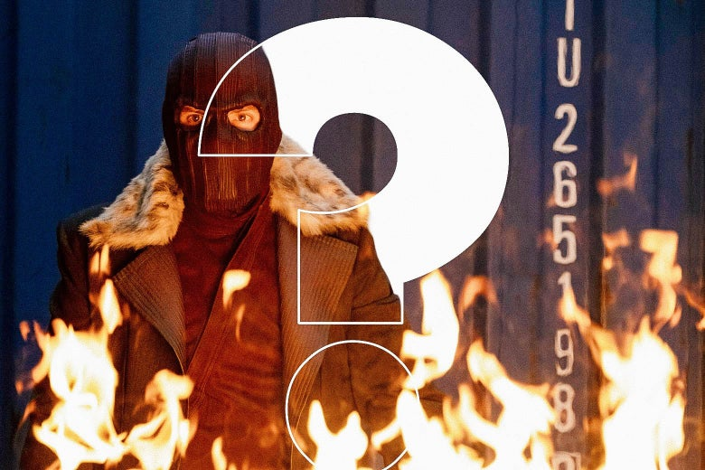 A masked white man in a heavy coat stands as a fire blazes in front of him. Over the image, a giant question mark.