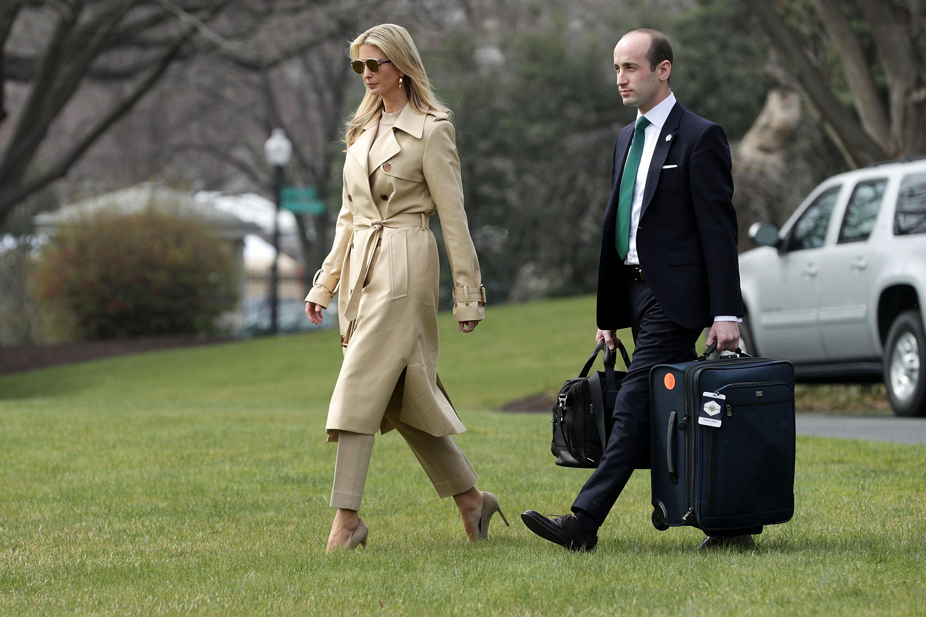 Ivanka Trump and White House Senior Adviser Stephen Miller walk across the South Lawn.