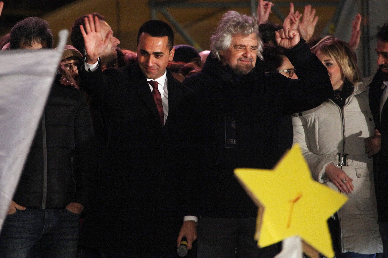 Luigi Di Maio and Beppe Grillo wave at the crowd.