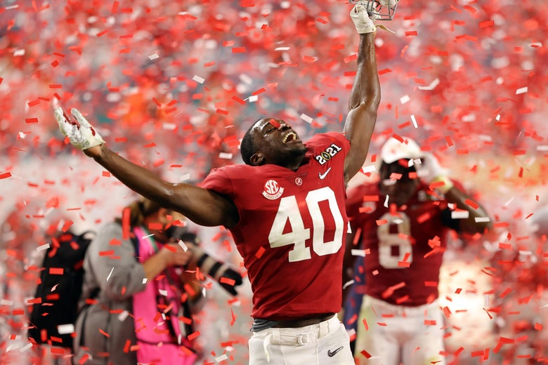 Joshua McMillon raises his arms and smiles upward as red and white confetti falls on him after Alabama's national championship win over Ohio State