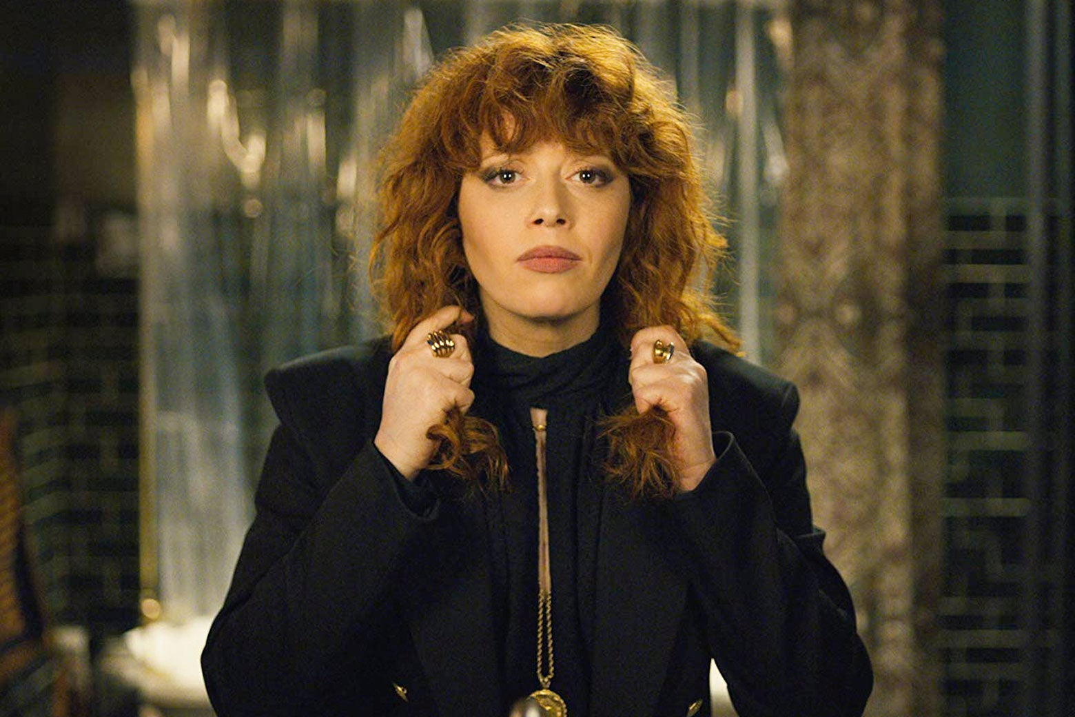Still from Russian Doll: Nadia, played by Natasha Lyonne, grabs fistfuls of her long red hair.