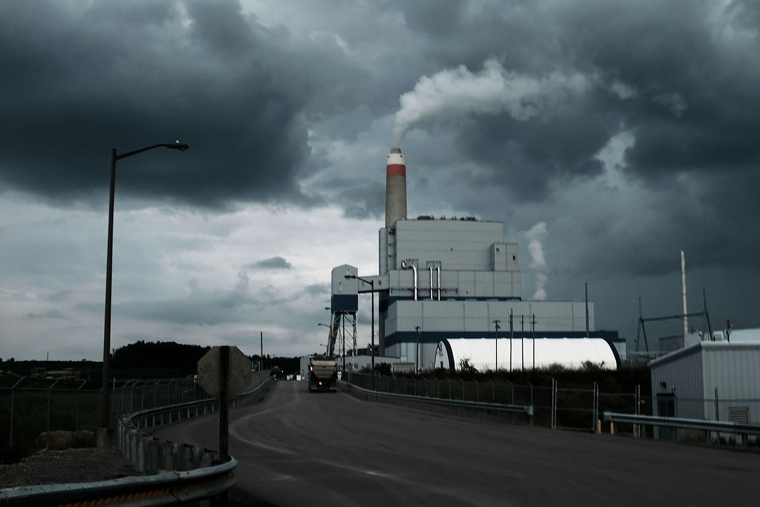 A power plant besides a road.