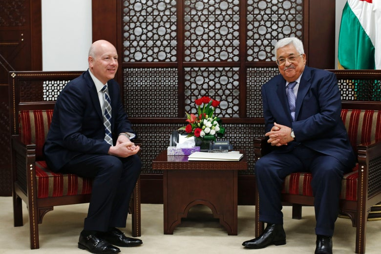 Greenblatt sitting beside Abbas.