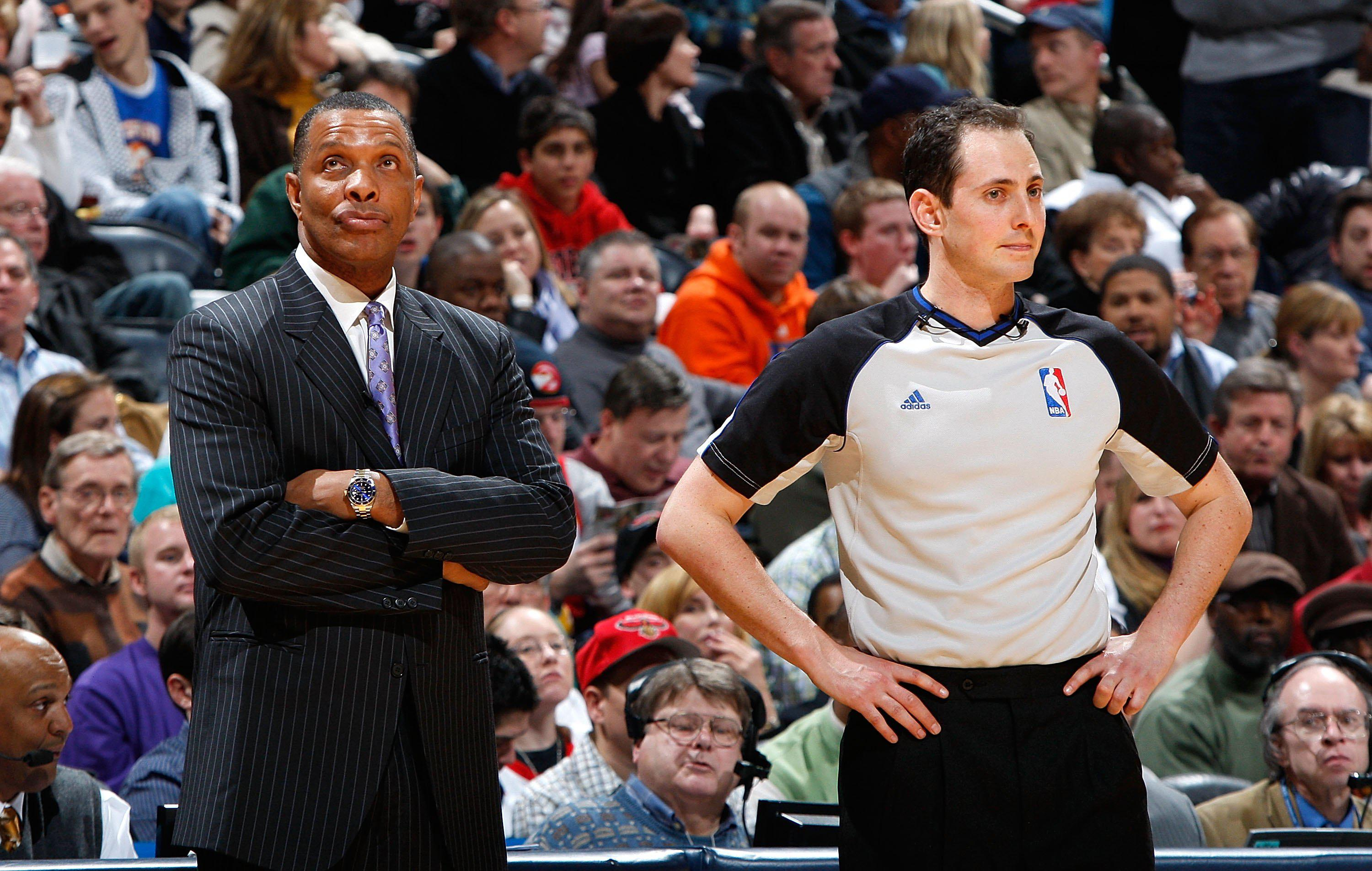 ATLANTA - JANUARY 15:  Head coach Alvin Gentry of the Phoenix Suns and referee Marat Kogut #68 (R) against the Atlanta Hawks at Philips Arena on January 15, 2010 in Atlanta, Georgia.  NOTE TO USER: User expressly acknowledges and agrees that, by downloading and/or using this Photograph, User is consenting to the terms and conditions of the Getty Images License Agreement.  (Photo by Kevin C. Cox/Getty Images)