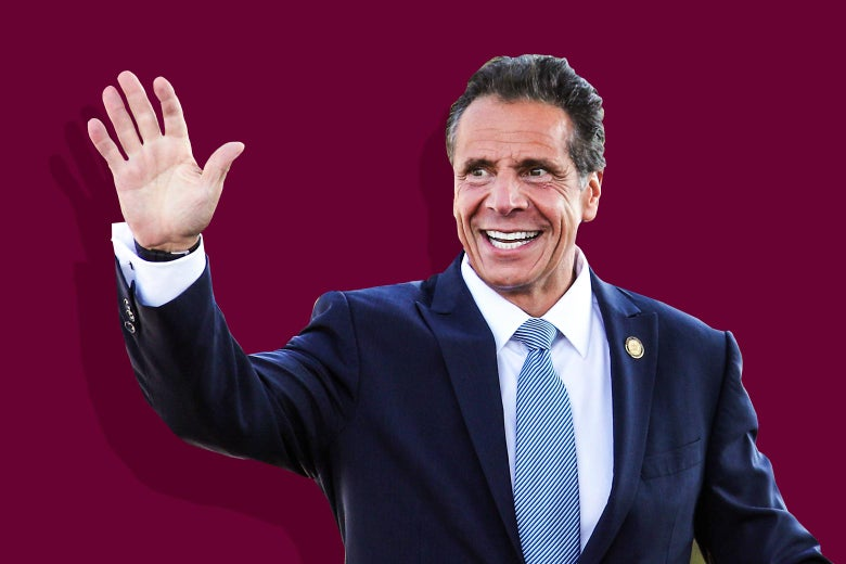 Andrew Cuomo smiles and waves.