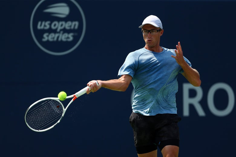 TORONTO, ON - AUGUST 06:  Peter Polansky of Canada plays a shot against Matthew Ebden of Australia during a 1st round match on Day 1 of the Rogers Cup at Aviva Centre on August 6, 2018 in Toronto, Canada.  (Photo by Vaughn Ridley/Getty Images)
