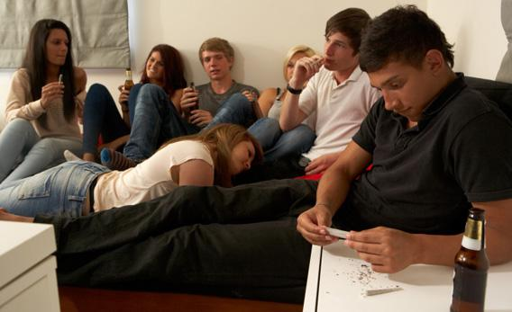 Teenagers drinking and smoking.