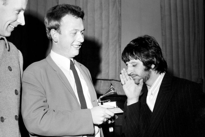 Geoff Emerick, Ringo Starr, and Emerick's Grammy for Sgt. Pepper's Lonely Hearts Club Band in 1968.