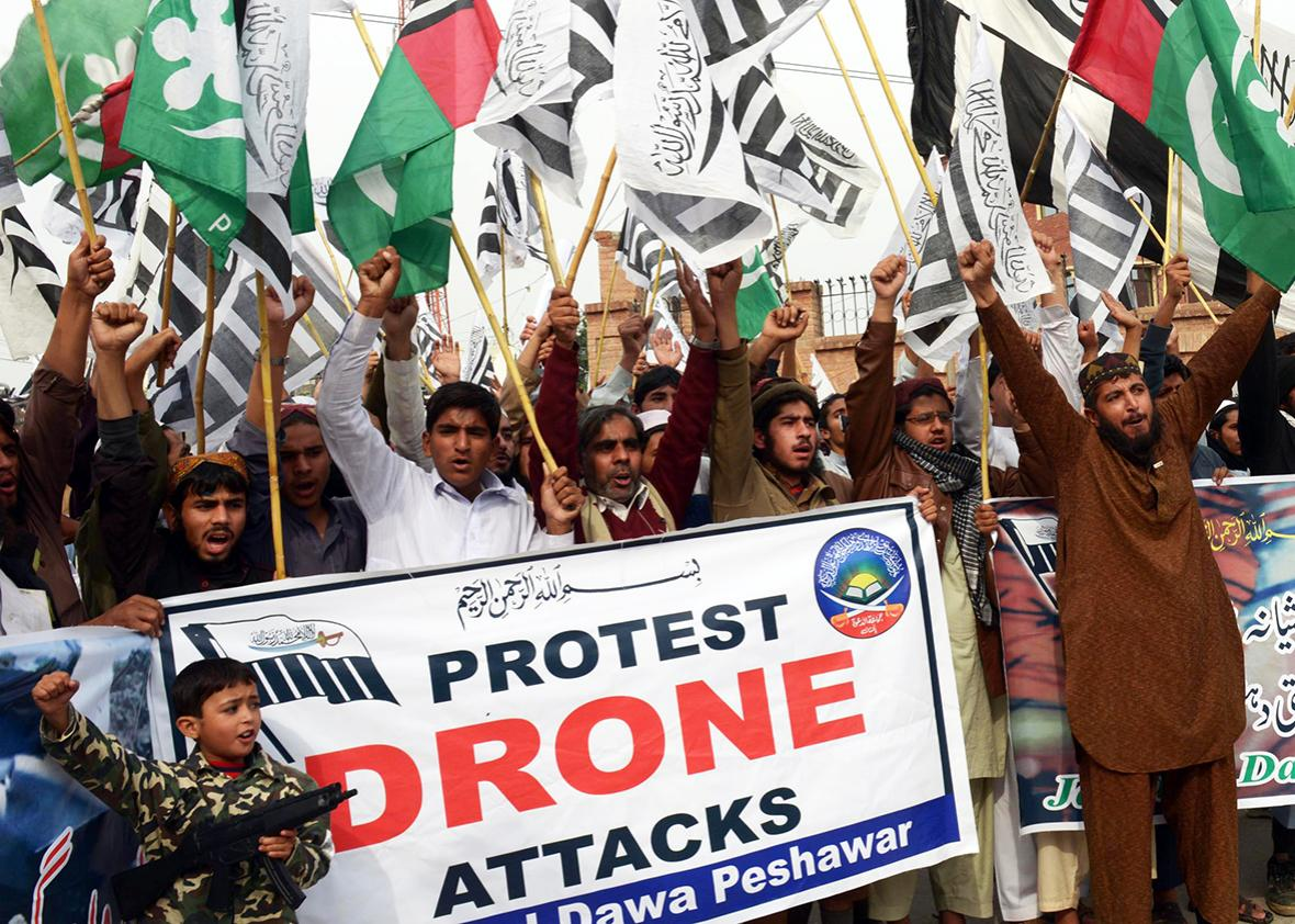 Supporters of Defense of Pakistan Council, a coalition of religious and political parties, chant anti-US slogans during a protest against the US drone strikes in the Pakistani tribal region, in Peshawar on November 10, 2013.