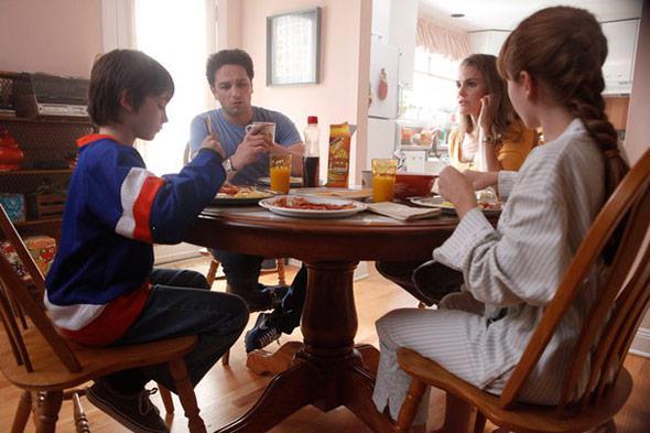 The Jennings sit down to breakfast.