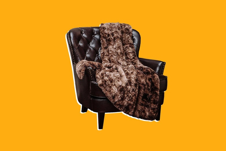 A faux fur blanket on a chair