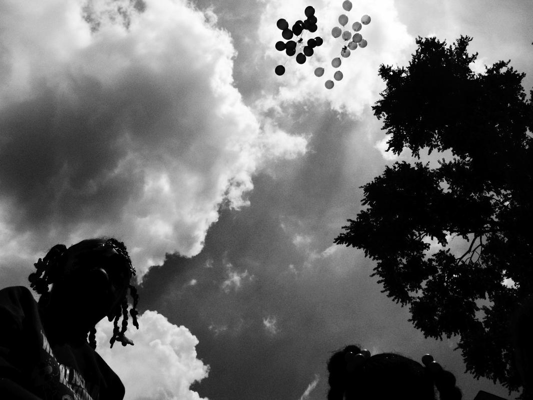 Balloons are released in memory of Siretha White and Starkeisha Reed during a block party on South Marshfield Avenue and West 69th Street. Englewood, Chicago, 2009.