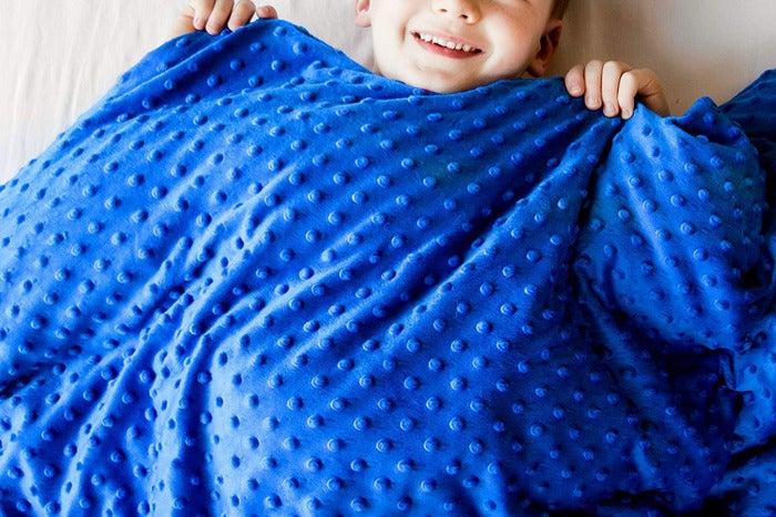 boy under a weighted blanket