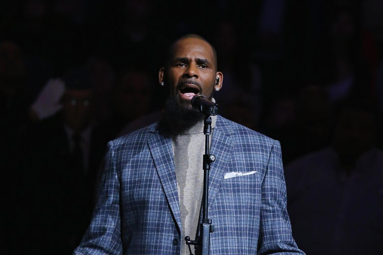 Singer R. Kelly sings the National anthem before the Brooklyn Nets vs the Atlanta Hawks  at The Barclays Center on November 17, 2015 in New York City.   NOTE TO USER: User expressly acknowledges and agrees that, by downloading and or using this photograph, User is consenting to the terms and conditions of the Getty Images License Agreement.