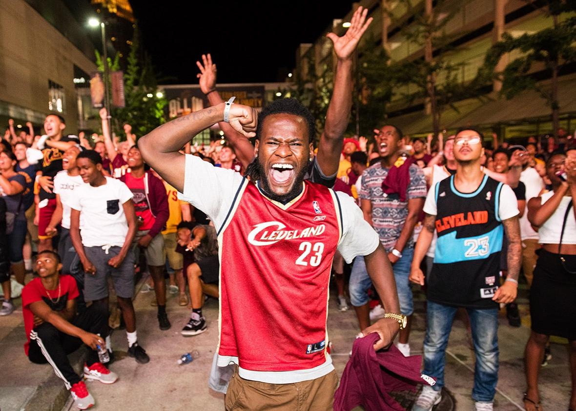Fans react to a play during the Cleveland Cavaliers NBA Finals Game Seven watch party at Quicken Loans Arena on June 19, 2016 in Cleveland, Ohio.