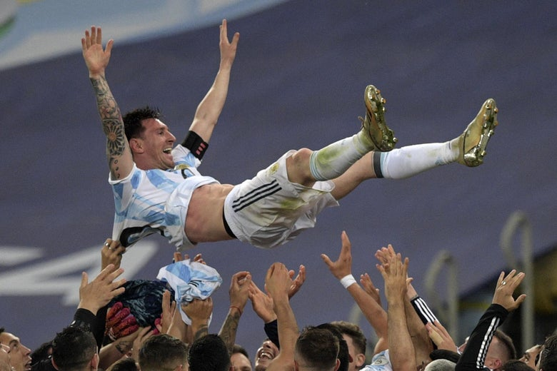Argentina's Lionel Messi is thrown into the air by teammates after winning the Conmebol 2021 Copa America football tournament final match against Brazil at Maracana Stadium in Rio de Janeiro, Brazil, on July 10, 2021.
